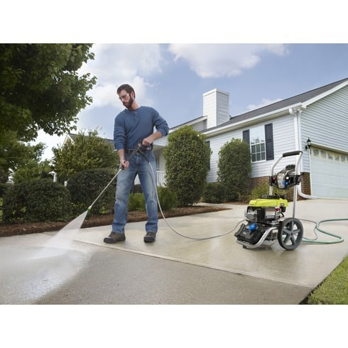 Ryobi 2800 PSI gas pressure washer man washing concrete