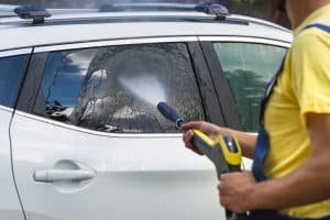 Carwash Man Working With High Pressure Washer