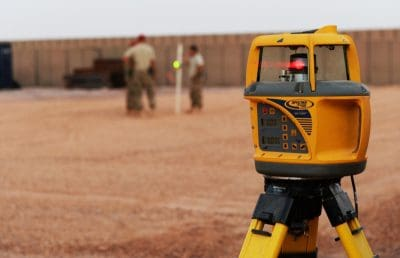 Laser level being used to take readings
