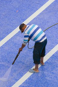 How to Clean the Pool Tile with a Pressure Washer Featured Worker Cleaning The Pool